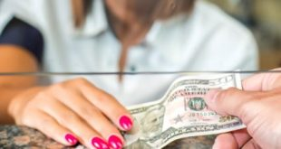 Bank teller giving consumer cash is another reason to have a bank account